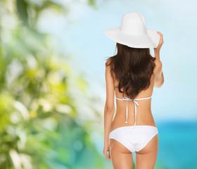 beautiful woman posing in white bikini