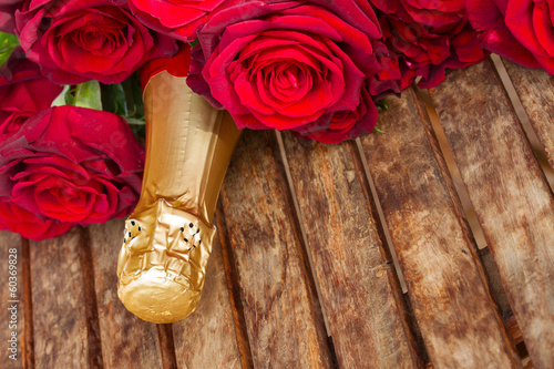 dark red  roses with neck of champagne
