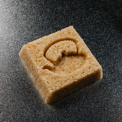Sugar cube made of brown sugar with the shape of a tea or kettle