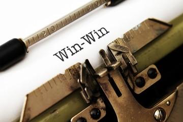 Win win text on typewriter