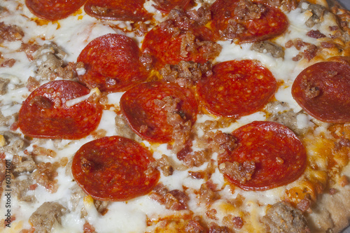 Close up on a meat lovers pizza.