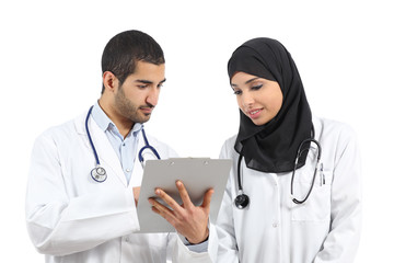 Saudi arab doctors diagnosing looking a medical history
