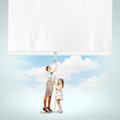 Woman and little girl pulling banner