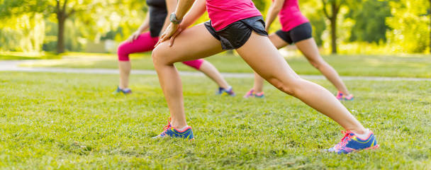 group of three women streching before jogging together