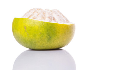 Pomelo or Shaddock fruit exposed flesh over white background