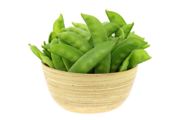 Fresh Peas in a wooden bowl isolated on white