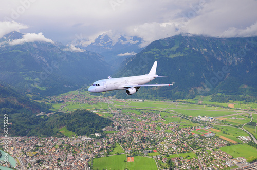 Passenger plane in the mountain valley.