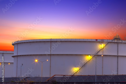 big Industrial chemical tanks in a refinery at twilight