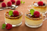 Creme brulee with raspberries and mint.