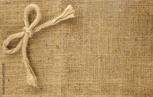 Beautiful bow on brown hemp background