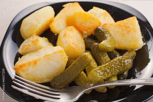 the boiled fried potato segments and pickles