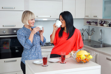woman friends chatting and drinking coffee