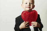 Smiling Child with Red Heart.Boy with Heart Symbol.Valentine