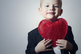 Happy Boy with Red Heart.Child with Heart Symbol.Valentine