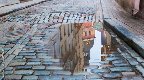 Cathedral reflection in a pool on a cobblestone road, Riga