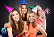 Joyful happy smiling teen girls have fun on birthday party