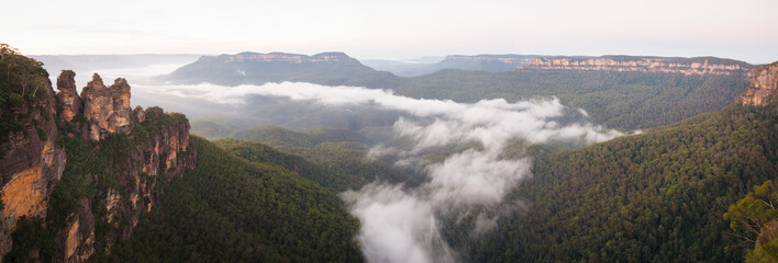 Fog lies in the valley below the iconic Three Sisters