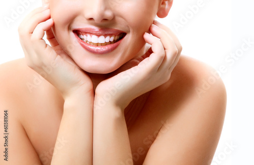 Smile. Young beautiful woman with perfect smile over white