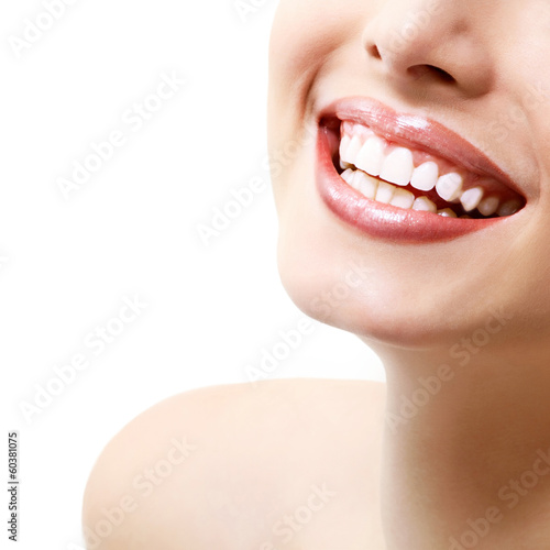 Smile. Young beautiful woman with perfect smile over white backg - 60381075