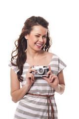 Winking female holding retro camera