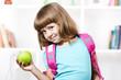 Schoolgirl with apple