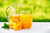 A jug and glass of fresh orange juice
