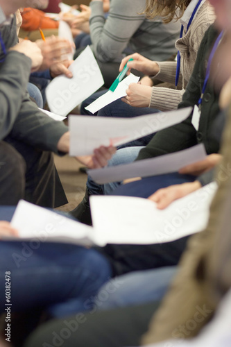 people taking note at business meeting