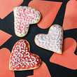Heart cookies baked Valentine's Day and hearts cut from paper