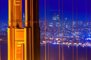 San Francisco Golden Gate Bridge sunset through cables