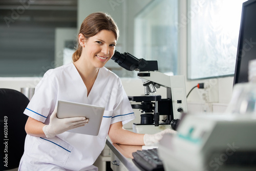 Female Scientist Holding Digital Tablet In Lab