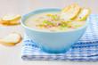 Delicious vegetable cream soup with potatoes, celery, ham, fresh