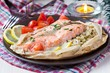 Salmon steak with rice, herbs, tomatoes, baked in parchment