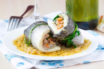 Fish rolls of dorado fillet stuffed shrimp and spinach, onion