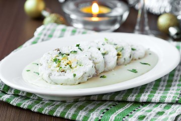 Roulade roll of white fish fillet cod stuffed with egg, sauce