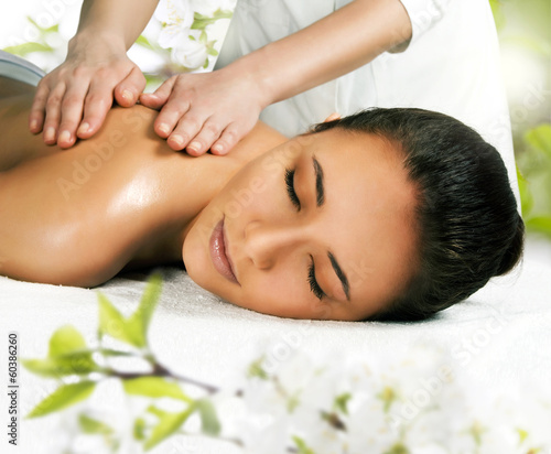 Beautiful girl getting a massage.