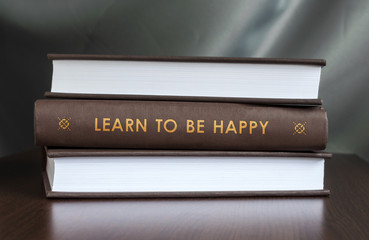 Learn to be happy. Book concept.