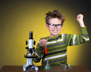 Young boy performing experiments. Little scientist.