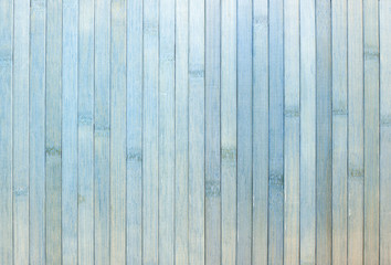 Background made of vertical gray-blue bamboo laths.