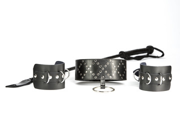 Fetish Hand cuffs, collar and whip made of black leather