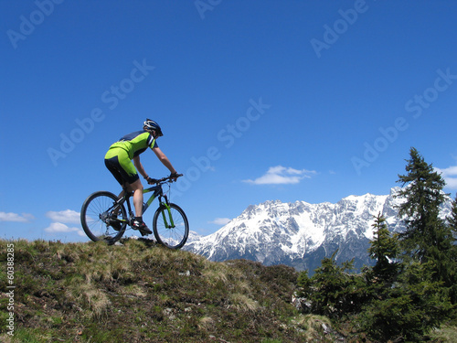 Mountain biker riding through European Alps