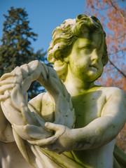 Cherub holding a wreath