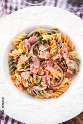 Fusilli pasta with bacon and onion