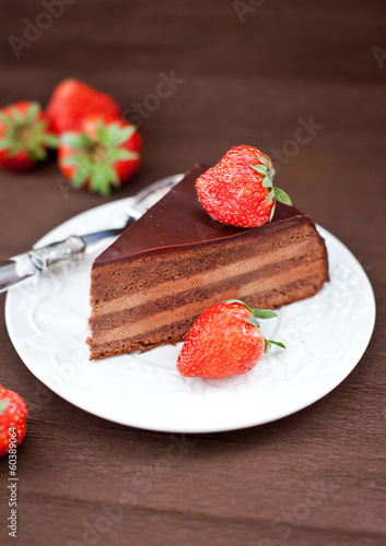 Piece of chocolate cake decorated with fresh strawberry