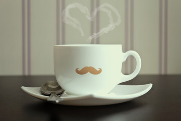 Moustache cup with steam in heart shape