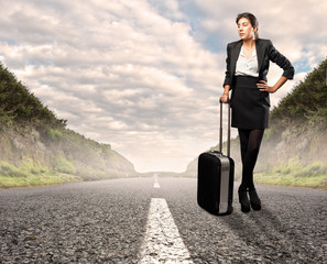businesswoman standing on road