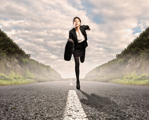 businesswoman on a road running