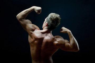 muscular young man with very strong arms