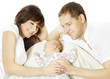 Happy family embracing sleeping newborn baby