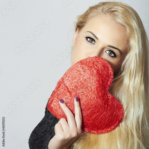Happy Young Blond Woman Holding Red Heart.Valentine's Day