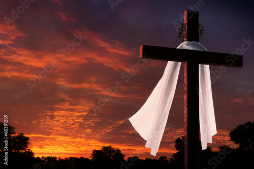 Dramatic Lighting on Christian Easter Cross at Sunrise - 60391289